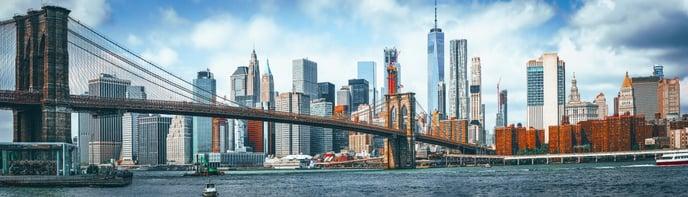 NYC Skyline with Brooklyn Bridge in forefront AdobeStock_298277186