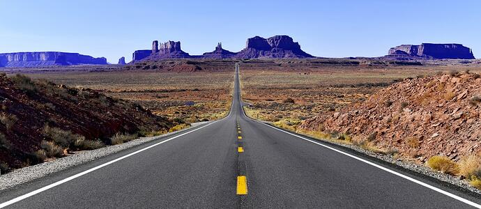 2 lane road leads into Southwest landscape AdobeStock_302566004