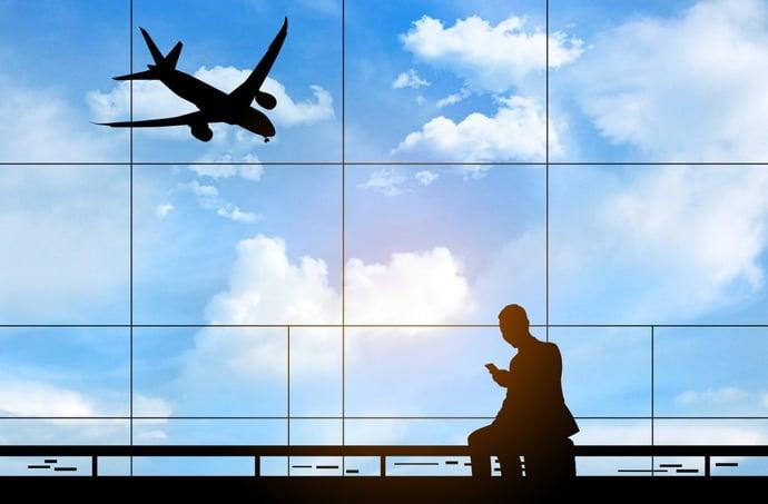 man in front of airport window AdobeStock_311583079