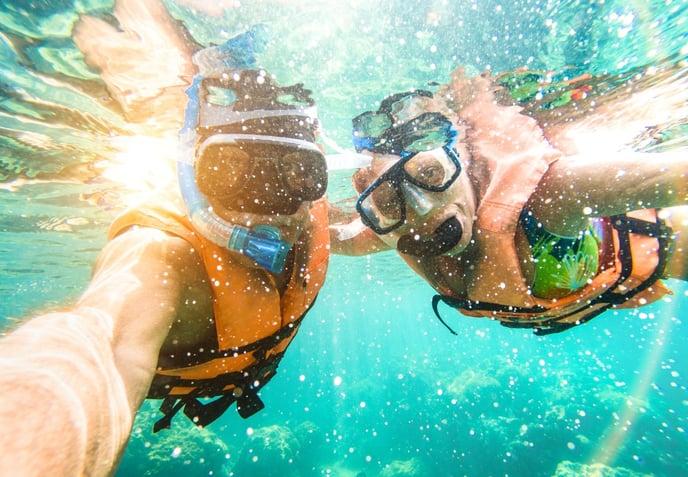 underwater snorkeling selfie with man and woman AdobeStock_192961661